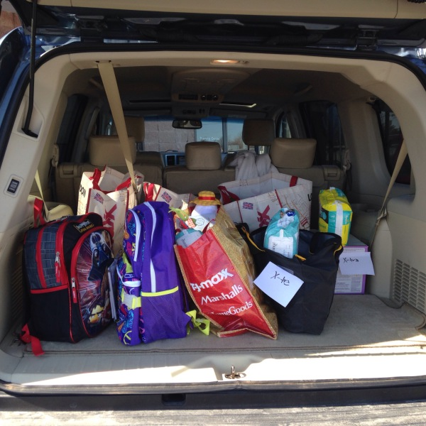 Community outreach donations for Ambassadors for Children//collected from families and teachers/backpacks for foster children