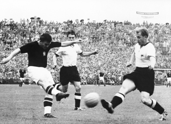 Ferenc Puskas takes a shot at goal at the 1954 World Cup final against West Germany