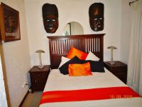 Mask bedroom Queen size bed in Ileven Heaven Harties self catering holiday accommodation