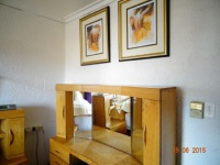 Dressing table with mirrors & prints in purple main en-suite bedroom