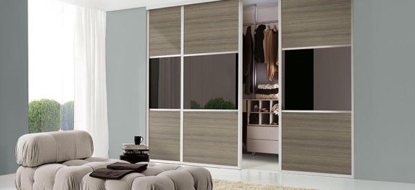 Aluminium Frames + Oak Panels and Black Glass.