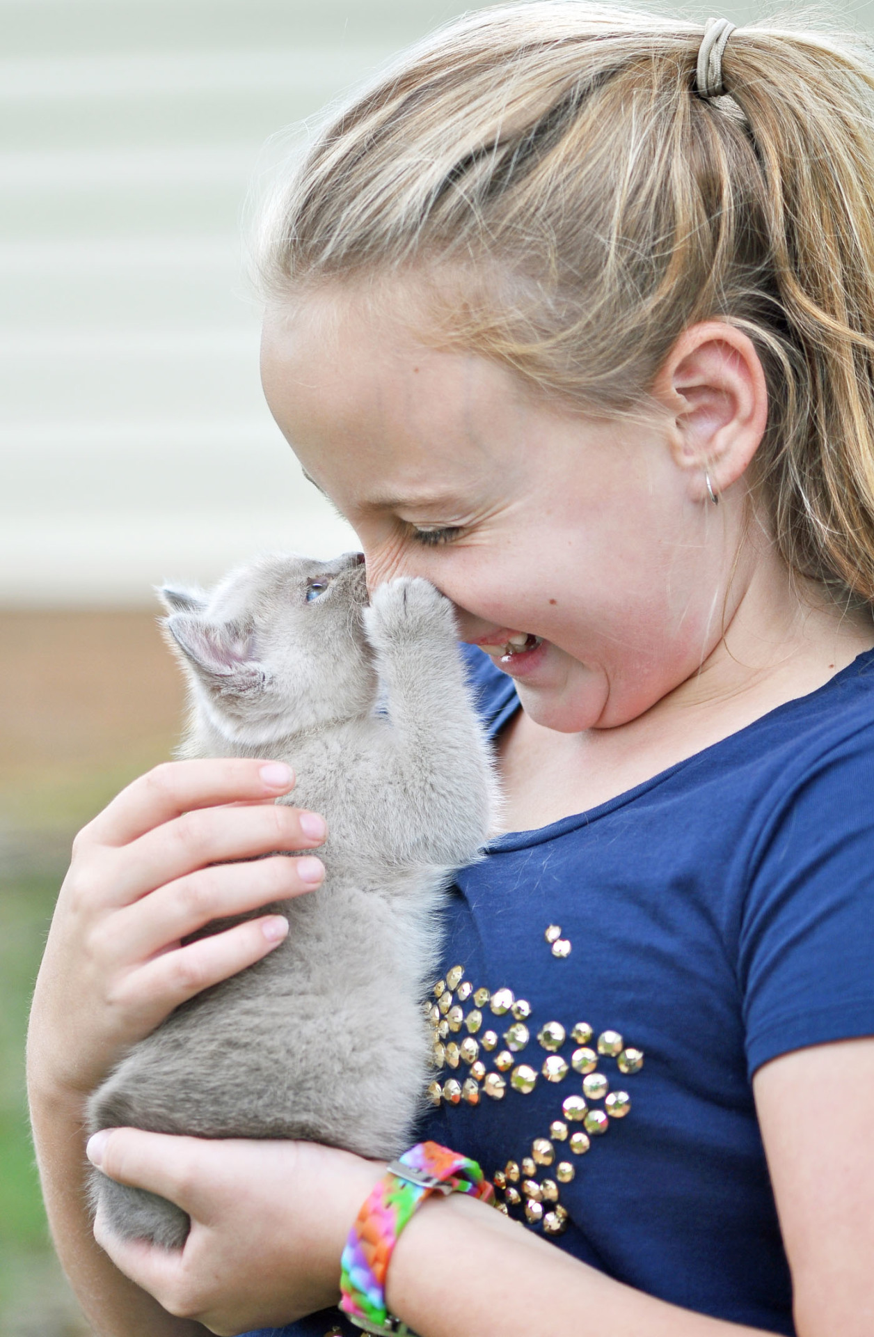 young girl with new kitten