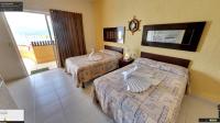 Habitación de la casa con 2 camas matrimoniales