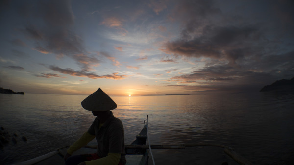 Fisherman contemplates the future as the sun sets in Southern Leyte