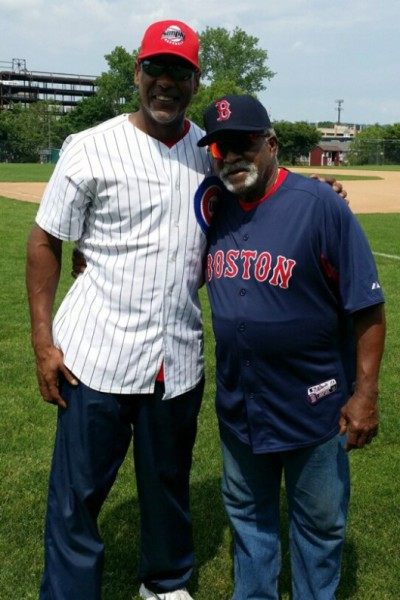 Angel Echevarria with Boston Red Sox Hall of Fame pitcher Luis Tiant
