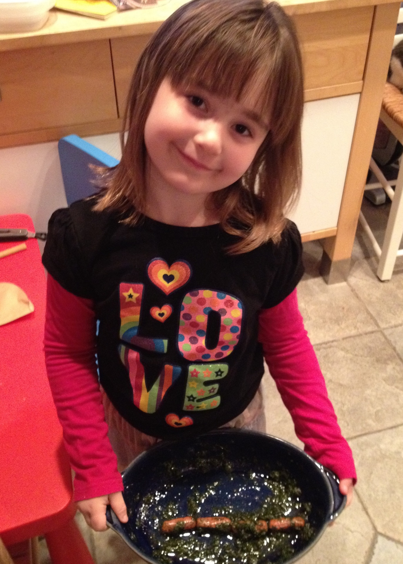 Claire, age 5, proudly serving her Seaweed Dogs