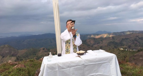Father Karl Celebrating Mass during a Mission.