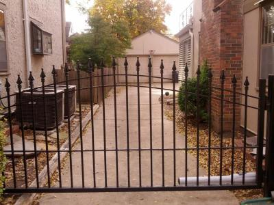 Custom Arched Iron Gates and Operators