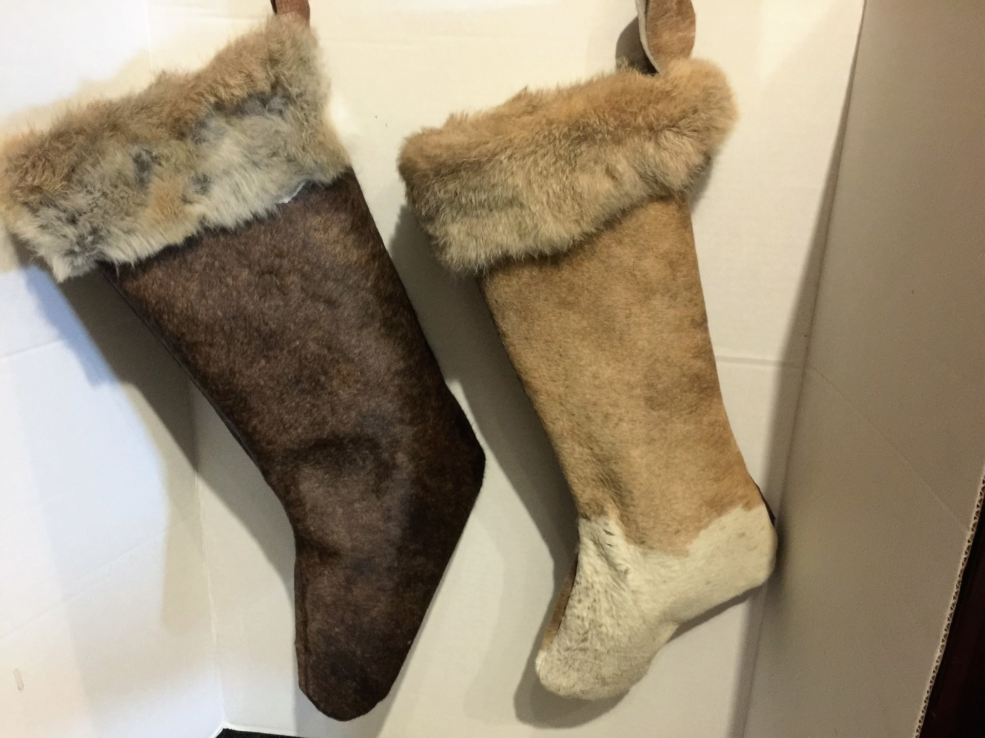 Cowhide Christmas Stockings trimmed with rabbit fur