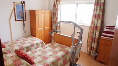 2 bed apartment twin bed with hospital bed and rise and recline bed