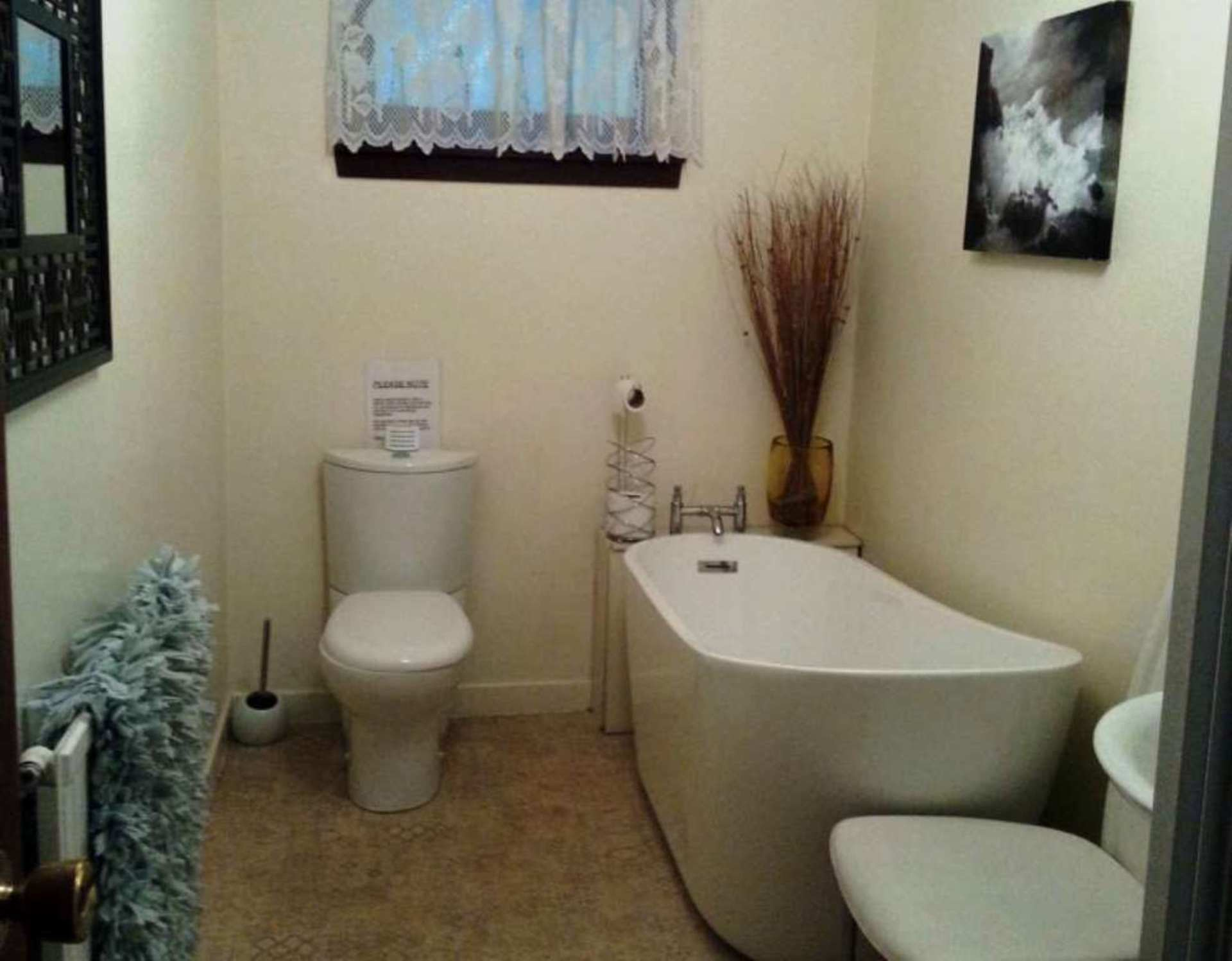 Main family bathroom with separate shower.