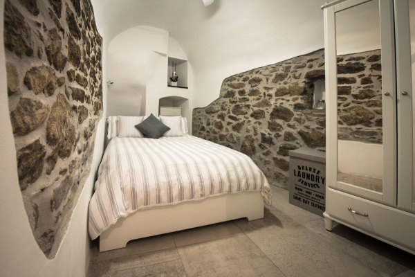 Bedroom featuring beautiful stone walls, Italian Riviera