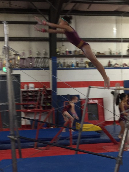 Ayleen leaping to high bar