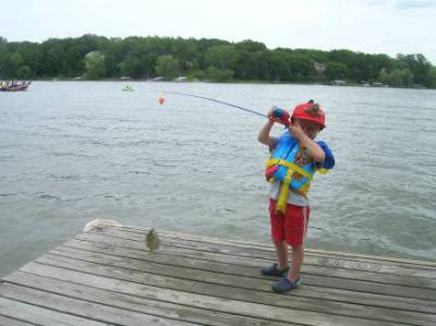 James catches his first fish - 2009