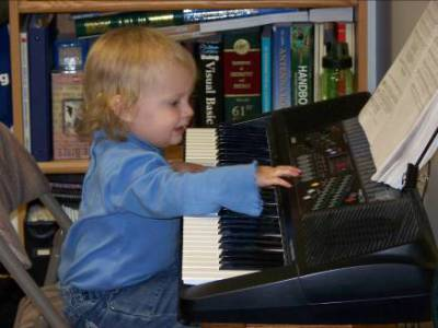 Adria plays keyboard in grandpa's shack – 2008