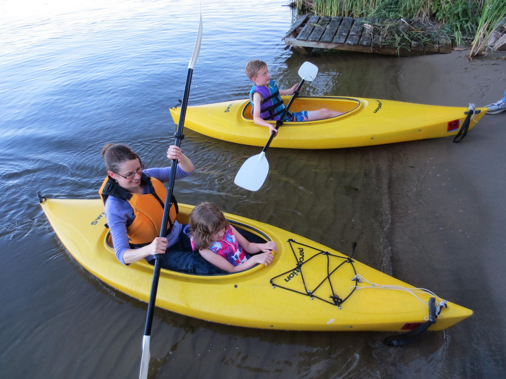 Kids and mom kayak on the lake - 2014