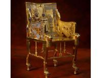 King Tut Throne – The Golden Throne of Tutankhamen The King Tut Throne is one of the most magnificent articles among the copious treasures of Tutankhamen discovered by Howard Carter in November, 1922. Also known as Tut's Golden Throne, the name may be a light misnomer, since it's likely that it was an auxiliary royal seat for the boy king. Also, the King Tut Throne is actually made primarily of wood, not gold, though it is beautifully overlaid in sheet gold and silver, further adorned with semi-precious stones, glaze, and colored glass.