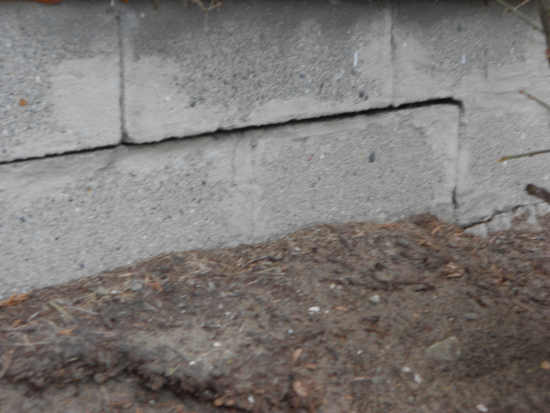 Mortar deteriorated and missing on block foundation wall causes leaky basement.