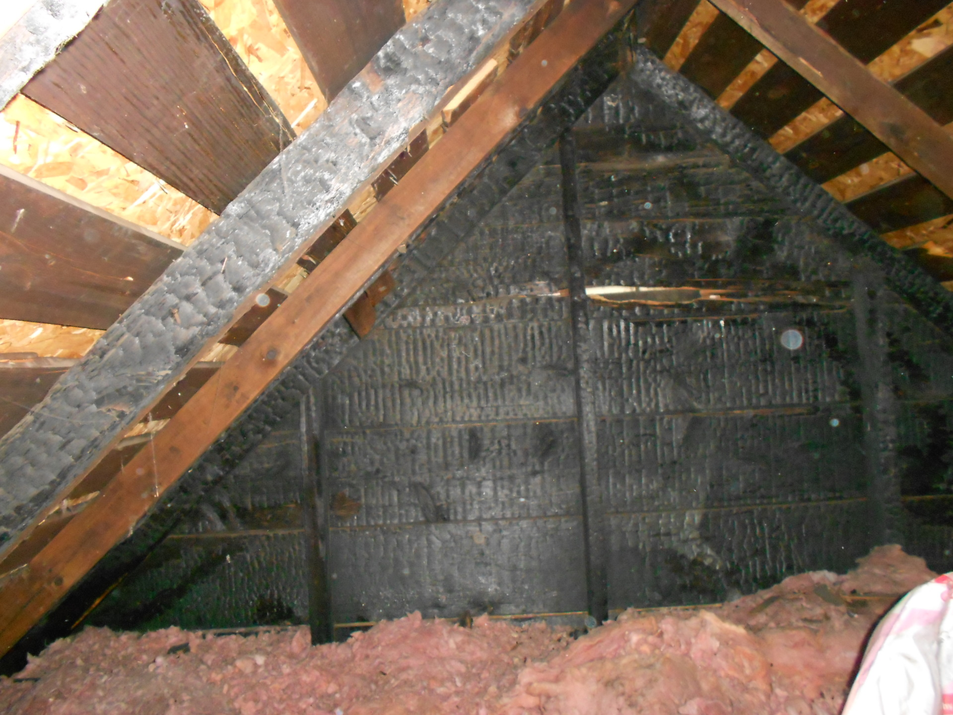 An attic fire caused burnt framing members.