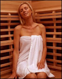 Woman sitting in an infrared sauna