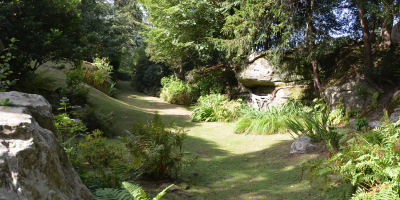Photo of meandering path through large listed garden