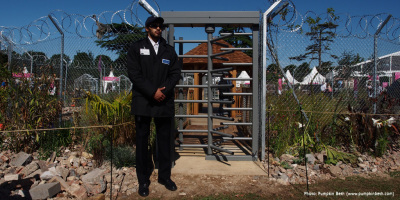 Photo of a border guard at the entrance of the UNHCR Border Control Show Garden designed by John Ward & Tom Massey