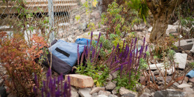 Photo of a discarded life vest in the UNHCR Border Control Show Garden designed by John Ward & Tom Massey