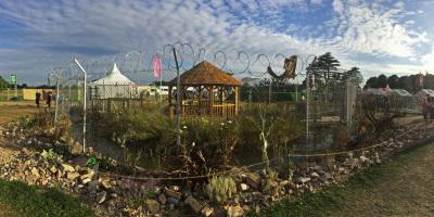 Fisheye photo of the UNHCR Border Control Show Garden designed by John Ward & Tom Massey