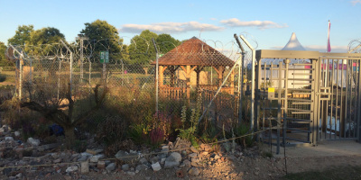 Photo of turnstile entrance to the UNHCR Border Control Show Garden designed by John Ward & Tom Massey