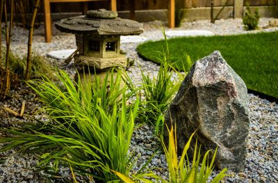 Photo of stone lantern and granite boulder in Japanese garden