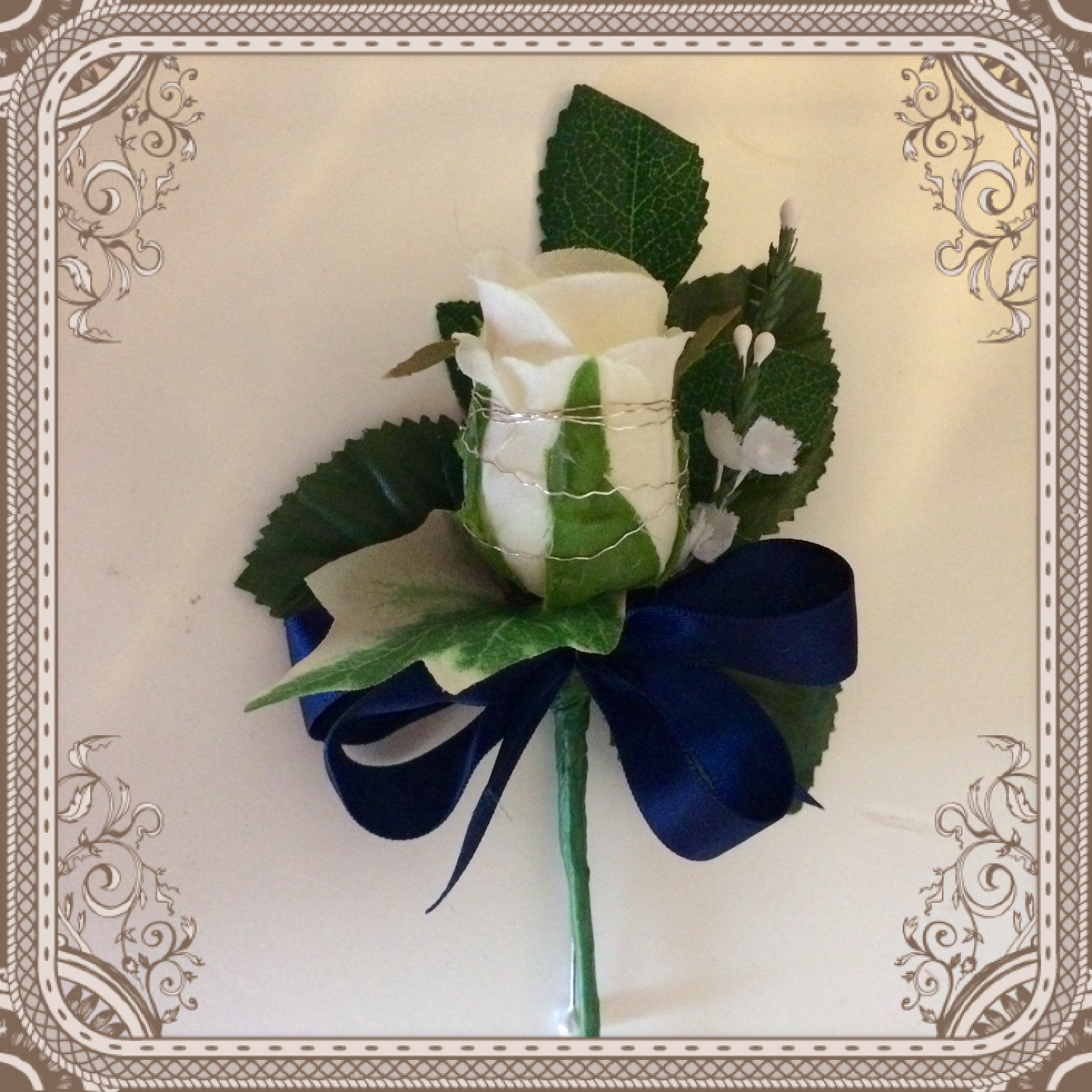 Ivory Rose & Navy Ribbon Gents Buttonhole from £3.50