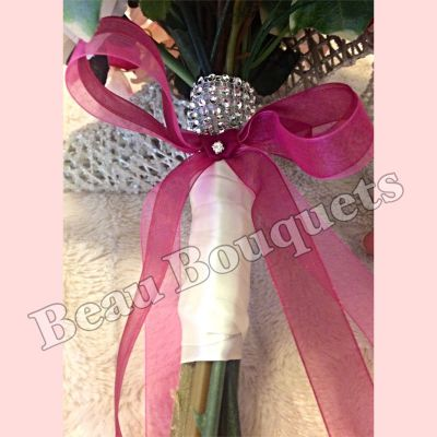 Realistic ivory & pink bouquet handle with showing stems & diamante ribbon touches
