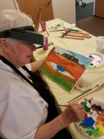 Joanna painting a southwestern landscape.