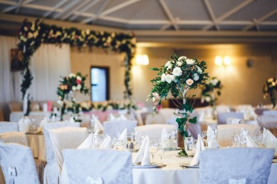 Floral centre pieces and backdrop
