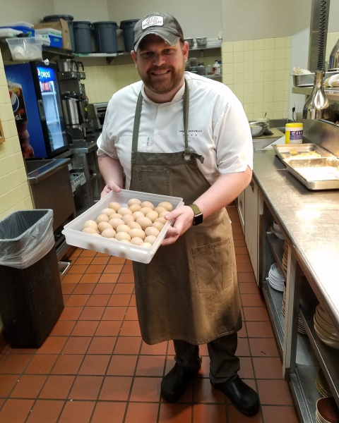 Chef Dave receiving his allotment of eggs