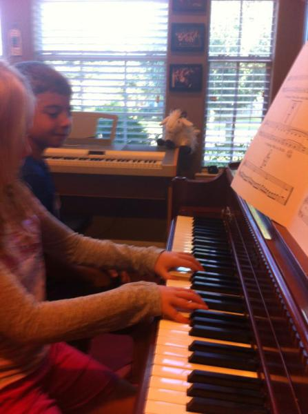 Piano friends playing duet