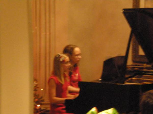 Friends playing duet at recital