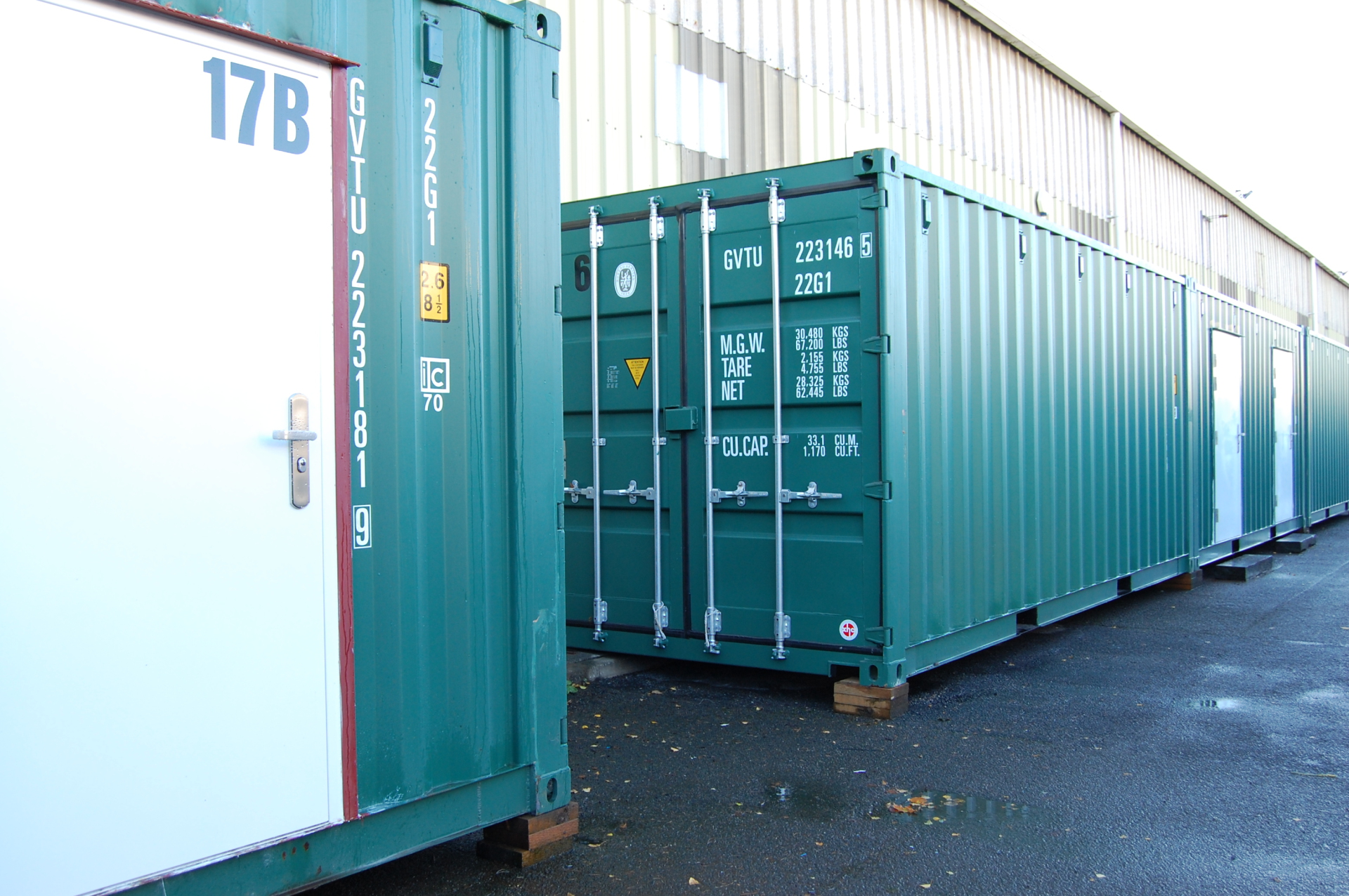 back to back green container doors