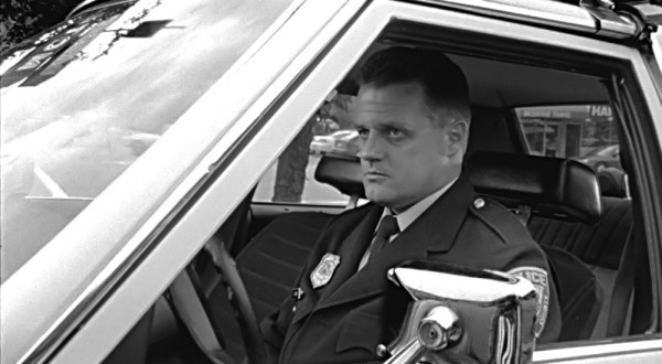 Officer Ned Zubick ( Ron Chartier ) is locked and loaded.