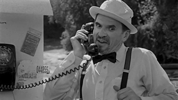 Harvey(Ron Sauve) finally gets his chance to take a call.