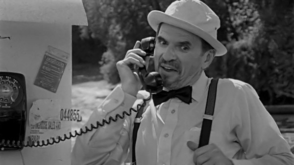 Harvey(Ron Sauve) finally gets his chance to take a call.