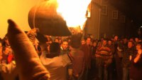 Villagers walk around with flaming tar barrels over their heads at 'Ottery Tar Barrels' festival.