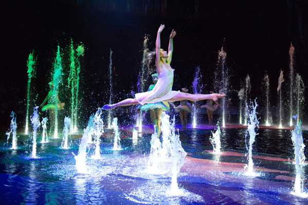 Lady dancing over fountain in 'The House of Dancing Water'