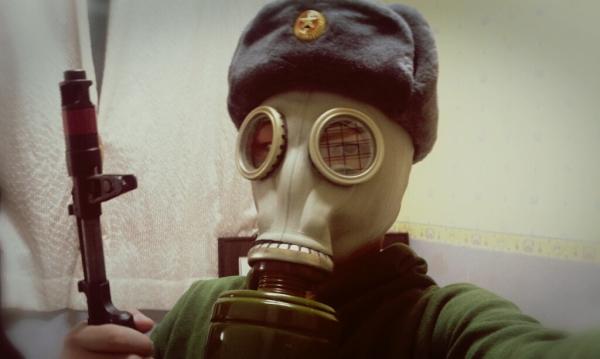 man wearing a gas mask during Soviet Era Survival Drama