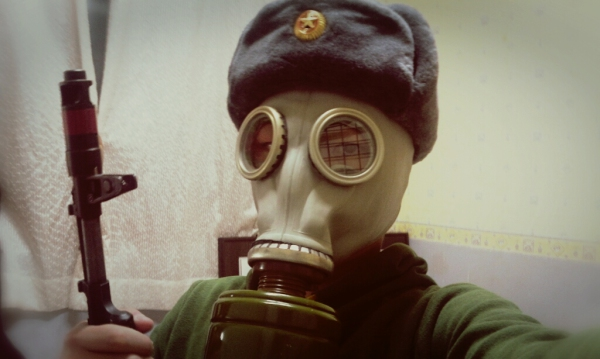 man wearing a gas mask during Soviet Era Survival Drama