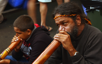 Two men playing didgeridoos at 'singing sticks' festival