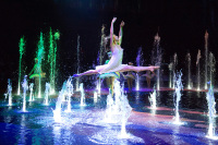 Dancer leaps over a fountain of water at 'The House of Dancing Water' live show