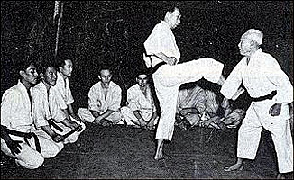 Gichin Funakoshi giving a demonstration.  He trained until his death at age 89