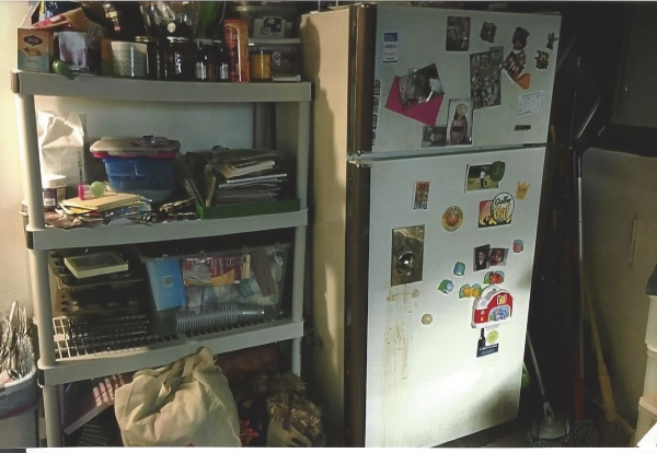 We had a shelf system without a system... it was a holding zone for stray crafts, recipes, party supplies... you name it.