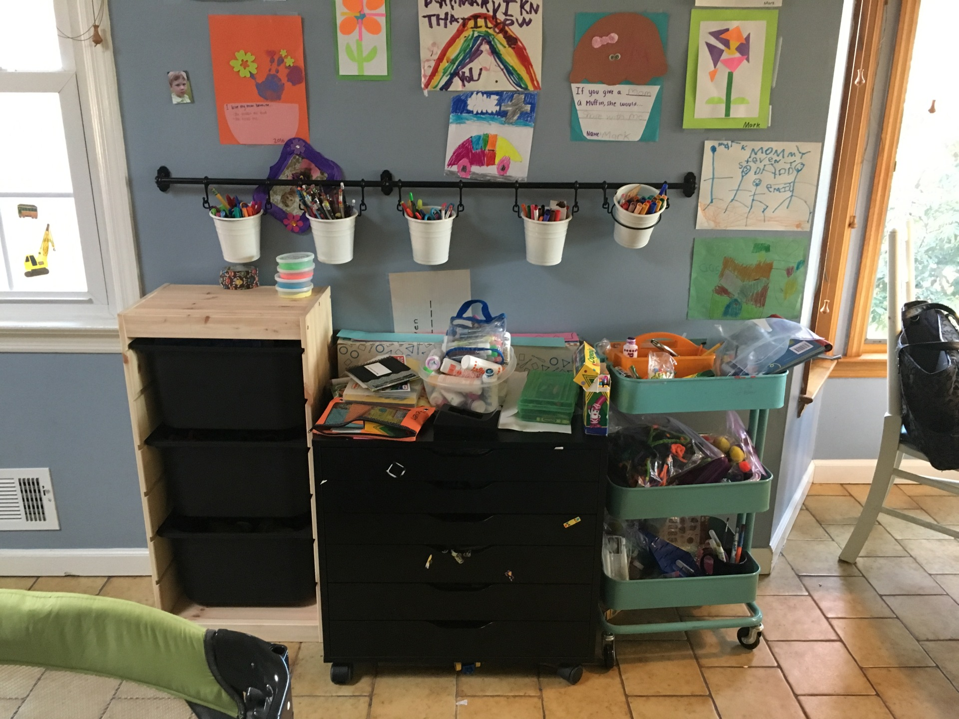 The imagination station!  The kids always flock to the kitchen anyway... Christine was so smart to set it up here!